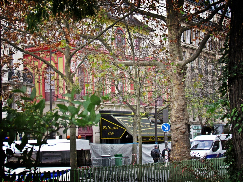 The Bataclan club, surrounded by a privacy shield and police cars